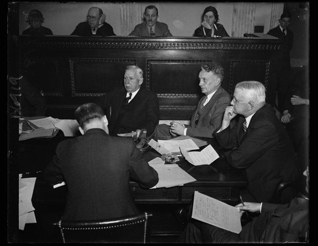 Munitions quiz opens on shipbuilders. The second phase of the Munitions Committee opened under Sen. Gerald P. Nye, R. of N.D., with representatives of shipbuilding concerns on the stand. This photo shows N.R. Parker, Treasurer of the New York Shipbuilding