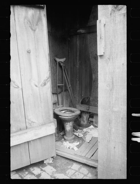 Negro slum, unkept privy, Washington, D.C. Within a few hundred yards of the new House office building is a row of these unkept privies
