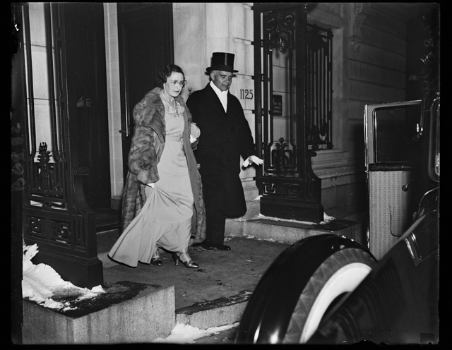 Off to White House. Ambassador and Madame Alexander Troyanovsky of the U.S.S.R., leaving the Embassy on 16th St., to attend the White House dinner given to the diplomatic corps. Ambassador Troyanovsky returned to Washington Thursday from a trip to his homeland so that he and his wife could attend the dinner. 1/24/35