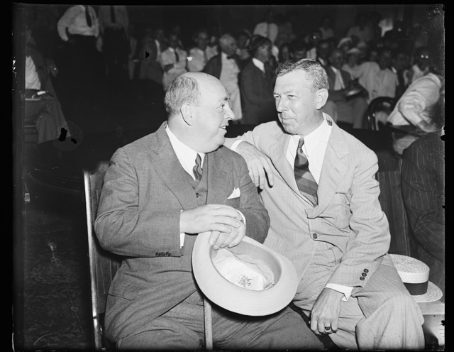 """On advise of counsel. Howard C. Hopson, left, long missing witness for the House Lobby Investigation Committee, confers with his counsel, William Hill of Boston, when he makes a belated appearance on the """"Hill."""" 8/13/35"""