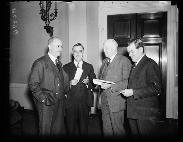 On refunding liberty bonds. Secretary of Treasury Henry Morgenthau, Jr., left, meets with members of the House Ways and Means Committee to discuss legislation concerning the refunding of the Second Liberty loans. From the left: Sec. Morgenthau; Rep. Fred M. [Vigson?], D. of Ky.; Robert L. Doughton, Chairman of the committee, and Rep. Wesley E. Disney, D. of Okla. 1/22/35