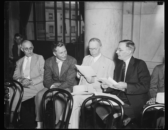 On the spot. Eugene Vidal, Director of the Air Commerce Bureau, left; Secretary Daniel Roper, and Malcolm C. Kerlin, his Administrative Assistant, at the Senate Commerce Committee hearing where Ewing Y. Mitchell, ousted official, repeats his charges of graft and corruption. 6/19/35