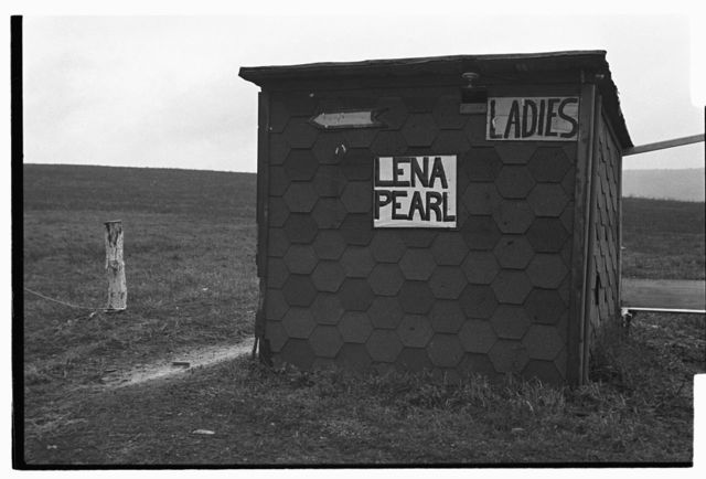 """Outhouse beside """"roadside barbecue,"""" Connellsville, outside Uniontown, Pennsylvania"""