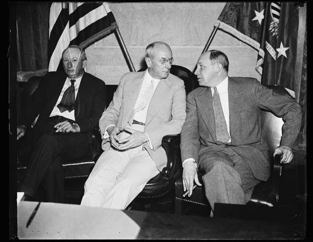 Picking up the pieces. Attorney General Homer S. Cummings, left, and Donald Richberg, Administrator of the NRA, meet in the Attorney General's office to plan a way to pick up the pieces of the Blue Eagle which were scattered by the Supreme Court decision