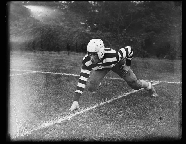 Pres. Wilson's grandson takes up football. Woodrow Sayre, son of Francis (State Dpt.) Sayre, and grandson of the late President, Woodrow Wilson, photographed in his football outfit at St. Albans School, Washington. Young Sayre recently clinched his job as regular right end of the team. 10/12/35