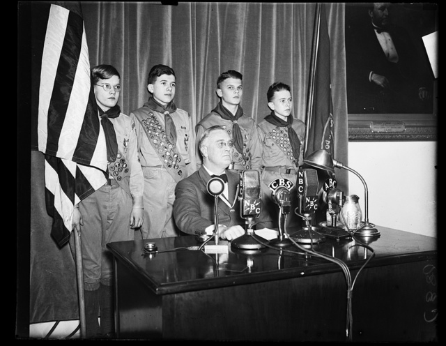 [PRESIDENT CONGRATULATES BOY SCOUTS. A SHORT RADIO ADDRESS WAS GIVEN BY PRESIDENT ROOSEVELT CONGRATULATING THE BOY SCOUTS ON THE 25TH ANNIVERSARY OF THEIR FOUNDING. FROM THE LEFT: BOLTON SMITH, VICE PRESIDENT OF B.S.A.; SYDNOR HODGES TROOP 97; GEORGE KEPHART, TROOP 33; LLOYD STREET TROOP 14; PHILIP COLE, TROOP 50; COLIN H. LIVINGSTON, ORGANIZER AND PRESIDENT FOR 15 YEARS; AND JAMES E. WEST, CHIEF SCOUT EXECUTIVE]