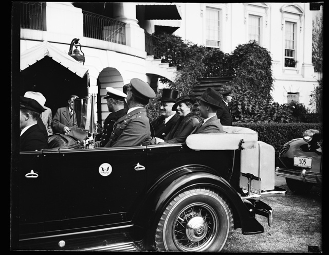 PRESIDENTIAL FAMILY LEAVES FOR ARLINGTON. PRESIDENT ROOSEVELT AND HIS FAMILY LEAVE THE WHITE HOUSE FOR ARLINGTON CEMETERY WHERE HE DELIVERED AN ARMISTICE DAY ADDRESS AT THE TOMB OF THE UNKNOWN SOLDIER. IN THE REAR SEAT, FROM THE LEFT: JOHN ROOSEVELT, THE SON; MRS. ROOSEVELT AND THE PRESIDENT