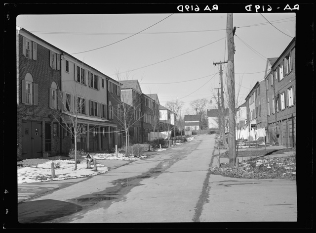Radburn, New Jersey, a privately financed model town which furnished some of the ideas for the Suburban Resettlement Administration's Greenbelt towns. A roadway, not a thoroughfare, back of a unit of houses