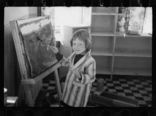 Radburn, New Jersey, a privately financed model town which furnished some of the ideas for the United States Suburban Resettlement Administration's Greenbelt towns. Young artist at the community kindergarten