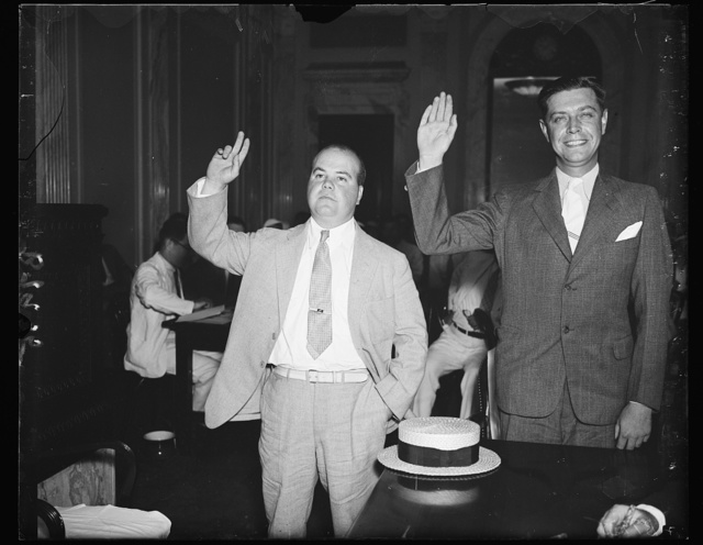 "Ready to testify. E.W. O'Brien, left and R.P. Herron, utility representatives being sworn in Thursday at the Senate lobby investigation. Both men are implicated in the anti-holding company bill ""telephone directory wire"" barrage that flooded Capitol Hill"