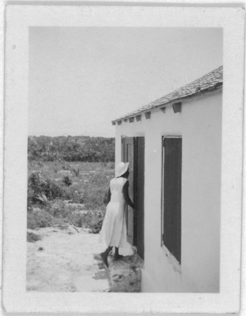 [Rear view of woman entering house, possibly from the visit by Alan Lomax and Mary Elizabeth Barnicle to Andros Island in the Bahamas]