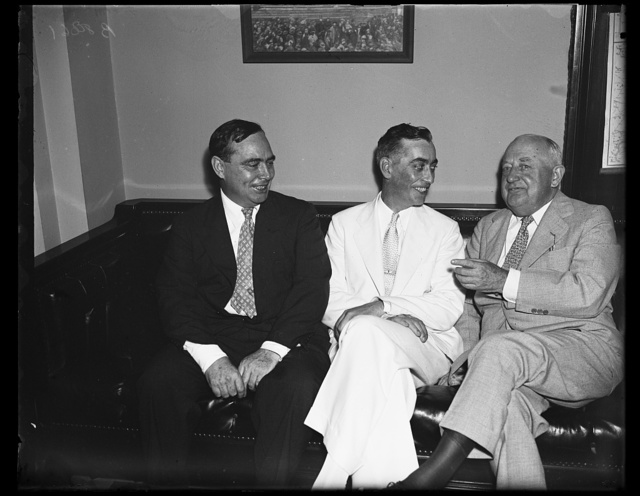 Rhode Island's new congressman. Republicans had a quiet little celebration as Chas F. Risk, center, prepared to take his seat as Rhode Island's Republican congressman. From the left: Joseph W. Martin, Jr., R. of Mass; Risk, and Minority Leader Bertrand H. Snell of New York. 8/19/35