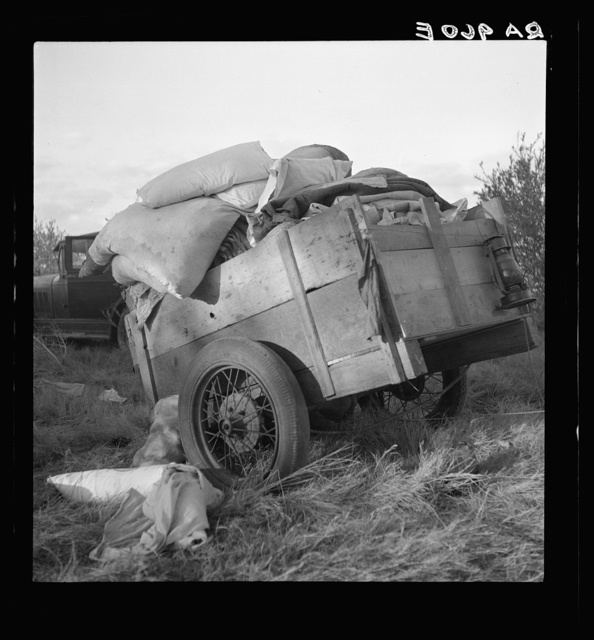 """Roadside camp near Bakersfield, California. """"Come to California."""" The wordly posessions of refugees from Texas dust, drought and depression"""