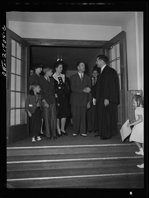 Rochester, New York. The minister greeting the Babcocks as they are leaving church after Sunday services