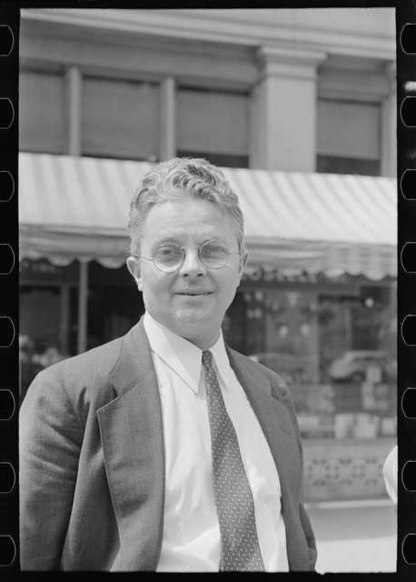 [Roy E. Stryker, photograph chief of the U.S. Farm Security Administration standing in street, probably in Washington, D.C.]