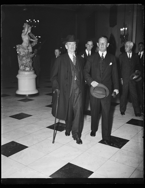 Sec. Claude Swanson, L., with Naval aide