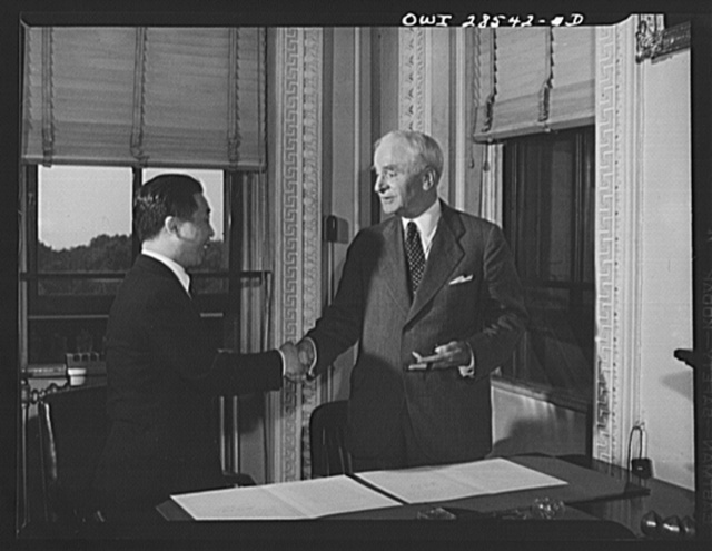 "Secretary of State Cordell Hull and Chinese Ambassador Wei Tao-Ming at the State Department exchanging ratifications of the treaty abolishing extra-territorial ""rights"" of the United States in China.  The treaty provided that it becomes effective at the time of this exchange"