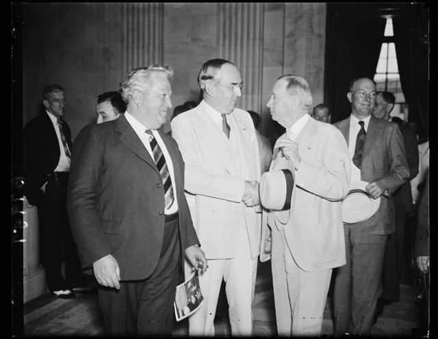 Senate passes on commerce tangle. Members of the Senate Commerce Committee and Secretary Daniel C. Roper, right, discuss phases of the charges hurled by ousted Assistant Secretary Ewing Y. Mitchell that graft exists in several bureaus of the Commerce Department. From the left: Sen. Pat McCarran, D. of Nev.; Sen. Arthur Vandenberg, R. of Mich., and Sec. Roper. The committee turned the investigation over to the Department of Justice, 6/20/35