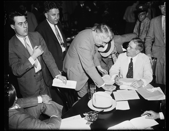 Sifting graft charges. Sen. Royal S. Copeland, D. of N.Y., left, chairman of the Senate Commerce Committee hearing graft charges offered by Ewing Y. Mitchell, right, ousted Assistant Secretary of Commerce. Mitchell was criticised several times by senators who said he was not revealing new information, but rehashing matters which were incorporatedin the Congressional record years ago, 6/19/35