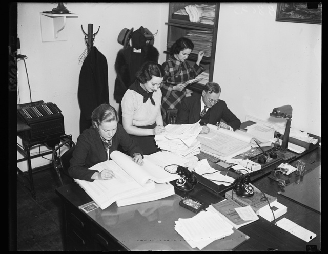 Spotting the dough. These employees of the Bureau of the Budget are preparing letters of allocation for the president's signature. They might be called the checker movers of the administration. 11/29/35