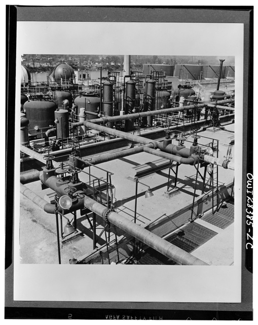 Storage. Grain alcohol is pumped from tank cars to storage tanks (shown in the background at the right) at the Institute plant at Institute, West Virginia. Operated by the Union Carbide and Carbon Corporation