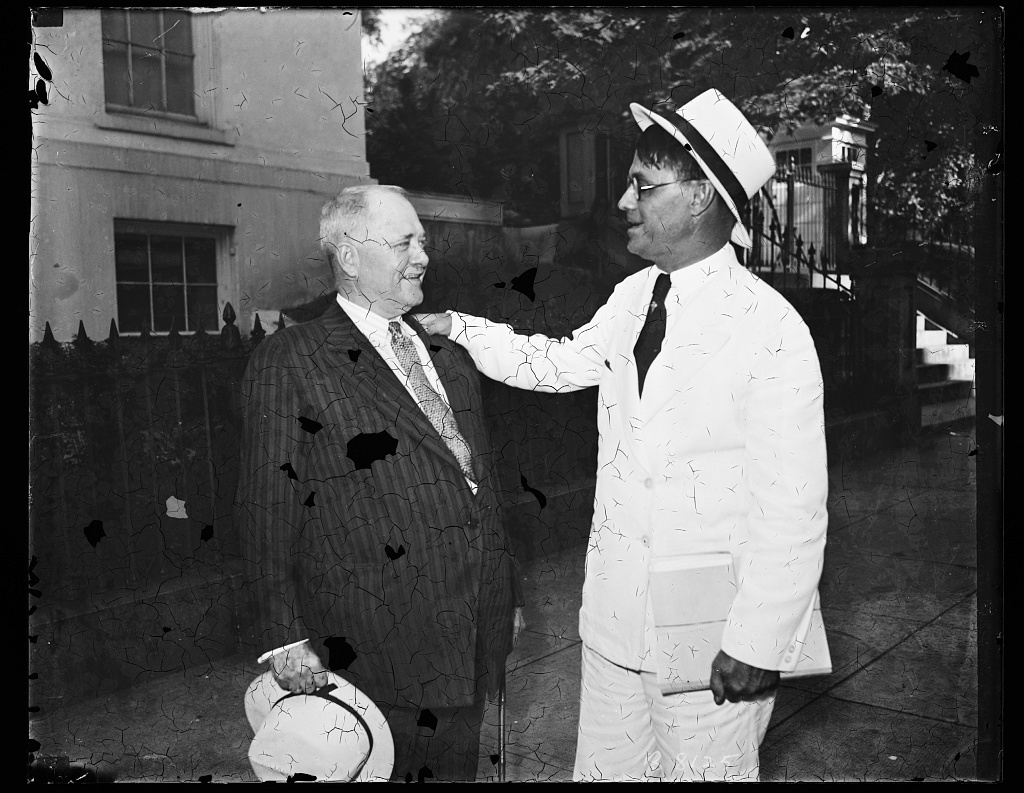 "Surprise visit from Georgia. Gov. Eugene Talmadge, of Georgia, consistent New Deal critic as he paid a surprise visit to Pres. Roosevelt at the White House Wednesday. Gov. Talmadge, in a cream colored suit, and red suspenders, indicated surprise when confonted by newsmen and photographers. ""How did you know I was coming here"" he asked. He was accompanied by Clark Howell, Atlanta, Ga., publisher. The two men are seen here leaving the White House, Gov. Talmadge at left, 7/17/35"