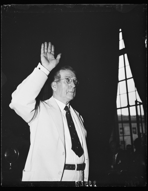Takes the stand. Ewing Y. Mitchell, the ousted Assistant Secretary of Commerce, takes the oath before the Senate Commerce to tell all he knows about alleged graft and corruption in his former department. 6/19/35