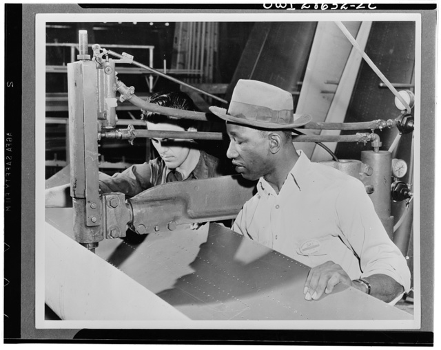 The six plane factories of the Douglas Aircraft Company have been termed an industrial melting pot, since men and women of fifty-eight national origins work side by side in pushing Americas's plane output. S. O. Porter, Douglas director of personnel, recently declared that Negros are doing an outstanding job in all plants. R. B. Santona and L. C. Ross work together in the El Segundo plant of the Douglas Aircraft Company