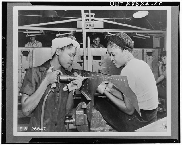 The six plane factories of the Douglas Aircraft Company have been termed an industrial melting pot, since men and women of fifty-eight national origins work side by side in pushing Americas's plane output. S. O. Porter, Douglas director of personnel, recently declared that Negros are doing an outstanding job in all plants. Luedell Mitchell and Lavada Cherry are shown in the El Segundo Plant of the Douglas Aircraft Company