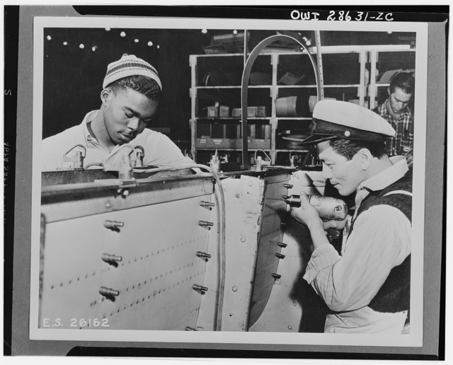 The six plane factories of the Douglas Aircraft Company have been termed an industrial melting pot, since men and women of fifty-eight national origins work side by side in pushing Americas's plane output. S. O. Porter, Douglas director of personnel, recently declared that Negros are doing an outstanding job in all plants. Richard Springfield and William Ung are employed in the El Segundo plant of the Douglas Aircraft Company