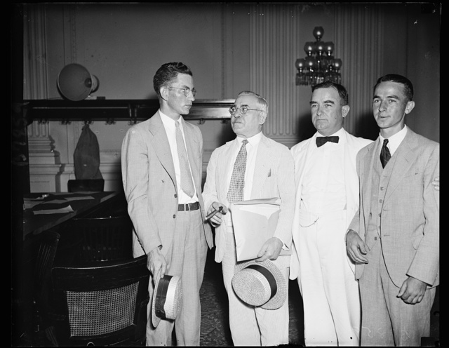 "They believe the box contained cigars. This quartet, photoed Thursday at the House lobby hearing made more news this week. L. to r.: Norman Shook, nephew of Rep. Patton, (who was reported to have said ""Hell, that box did not contain cigars"") Rep. Adolph J. Sabath (D. of Ill), Rep. Nat Patton (D. of Tex.) and Nat Patton Jr., who arrived on Capitol Hill Thursday by plane from Texas to be with his dad in his attempt to ward off suspicions that the Congressman may have received some cash favors for his vote on the Utility death sentence last month. 8/1/35"