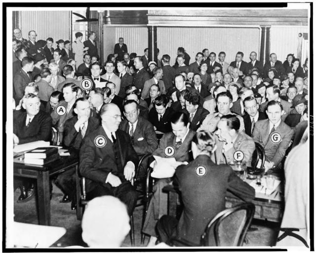 This picture, made just before court opened today, shows how the room looks to Justice Thomas W. Trenchard.  Identified are: Charles A. Lindbergh (A), Colonel H. Norman Schwarzkopf (B), Edward J. Reilly (C) in friendly conversation with Attorney General David T. Wilentz (D), Egbert Rosecrans (E), Floyd Fisher (F) and Bruno Richard Hauptmann (G) / World-Telegram staff photo.
