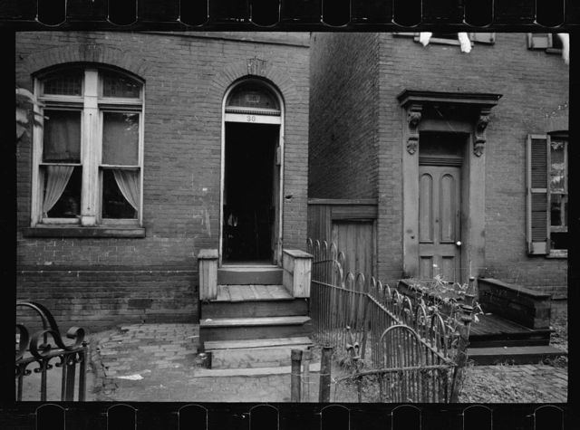 Typical house entrance near Union Station, Washington, D.C. These old brick structures are for the most part inhabited by Negroes. Toilets of these same houses are usually outside and most unsanitary