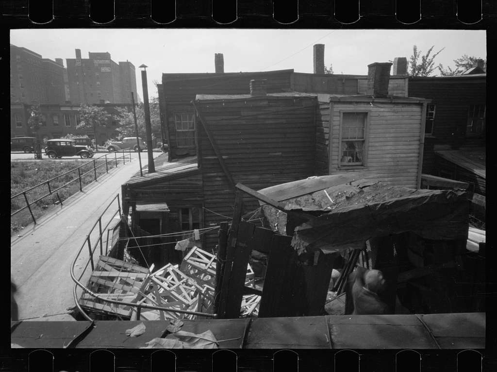 Untitled photo, possibly related to: Negro backyard, Washington, D.C. Backyard near Stratford Hotel and within short distance from both the Capitol and Union Station, showing flooded yard and debris. In big rains, kitchen and bedroom floors of this house are so flooded that it is necessary to lay planks on them, the inhabitants say