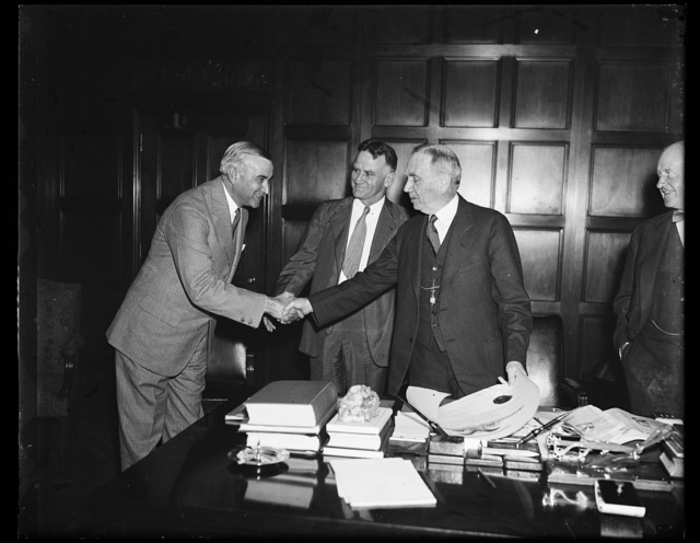 Wash. D.C. Draper gets Commerce post., Ernest G. Draper, left, of New York City, about to receive his commission as Assistant Secretary of Commerce from Secretary Daniel C. Roper. From the left: Draper, Assistant Secretary J.M. Johnson and Secretary Roper. 9/12/35