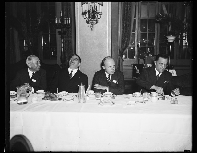 Wash. D.C. Funny. Mayor F.H. LaGuardia, right, finds something quite amusing as he sits beside Mayor Howard W. Jackson of Baltimore, at the luncheon given the U.S. Conference of Mayors at the opening session here today. Mayor LaGuardia eveidently is NOT thinking about the relief