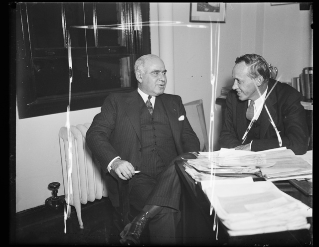 Wash. D.C. Relief for N.Y. Gov. Herbert Lehman of New York, left, confers with FERA Harry Hopkins on relief funds for his state. The Governor said he was running short. Hopkins may fix this up. 11/7/35