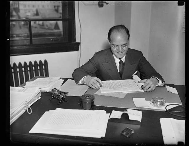 Wash. D.C. To push A.T. & T. quiz. Samuel Becker of Milwaukee, photographed at his desk where he is talking over his duties as special assistant counsel for the Federal Communications Commission where his telephone investigation. His salary is $9,000 a year. 10/4/35