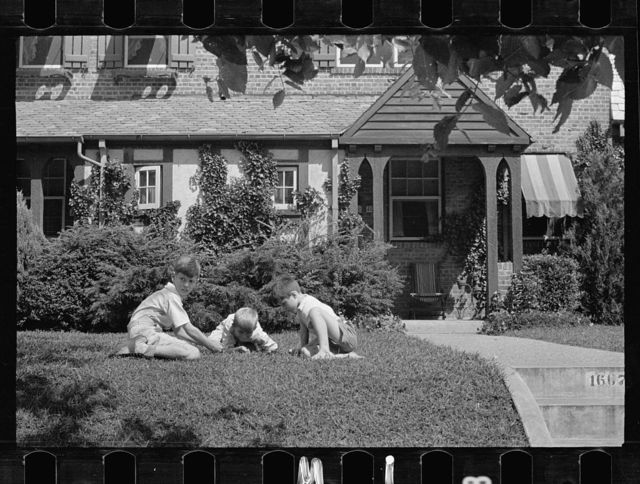 Washington's healthy children. At play on the front lawn of one of Washington's better housing sections. These houses have both sweeping front lawns and clean backyards