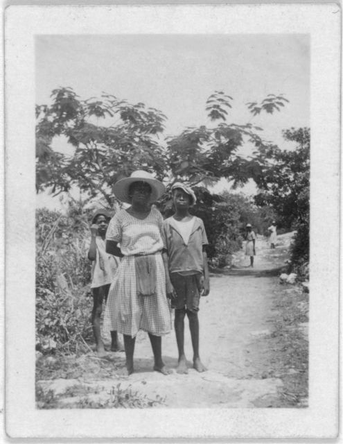 [Woman and boy standing in road, possibly from the visit by Alan Lomax and Mary Elizabeth Barnicle to Andros Island in the Bahamas]