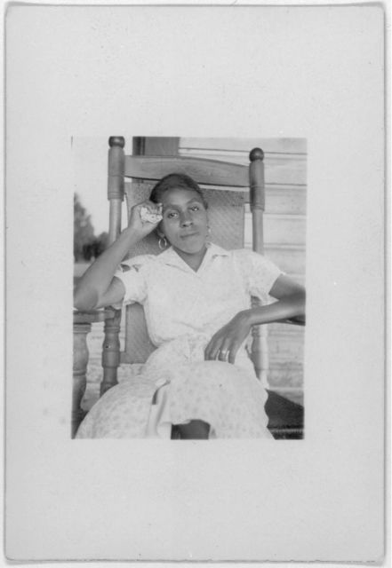 [Woman seated in rocking chair, Eatonville, Fla., facing forward,  taken during the Lomax, Hurston, Barnicle 1935 expedition to Georgia, Florida and the Bahamas]