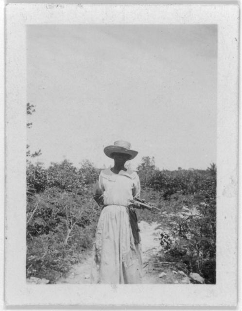 [Woman standing, facing  front, possibly from the visit by Alan Lomax and Mary Elizabeth Barnicle to Andros Island in the Bahamas]