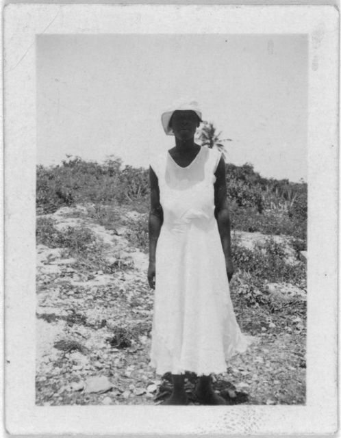 [Woman standing, full-length, facing front, possibly from the visit by Alan Lomax and Mary Elizabeth Barnicle to Andros Island in the Bahamas]