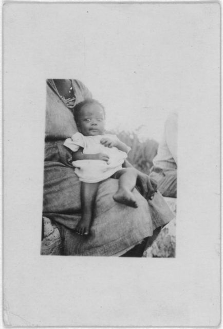 [Young baby held by mother, Old Bight, Cat Island, Bahamas, July  1935]