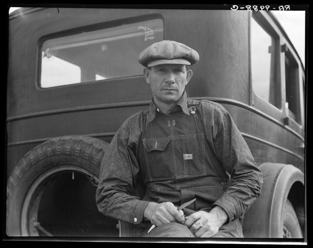 1936 drought refugee from Polk, Missouri. Awaiting the opening of orange picking season at Porterville, California