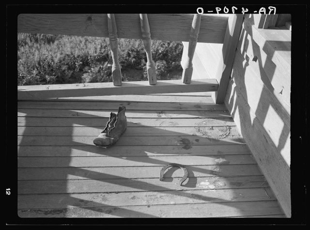 A horsehoe that did not bring luck and a boy's old shoe that trod miles to and from a small one-room is the only evidence of human habitation that remains at this deserted farmhome in the arid and wind blown section of central Oregon where dryland wheat farming once poured gold into the homesteaders' pockets
