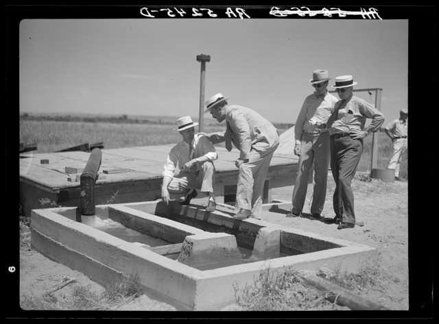 A little water for a thirsty land. Drought committee inspects artesian well irrigation project. Baca County, Colorado