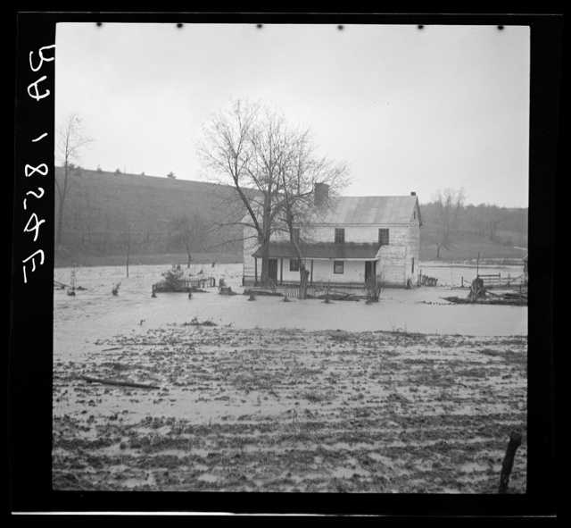 A low-lying farm being slowly engulfed by the rising waters of a West Virginia stream