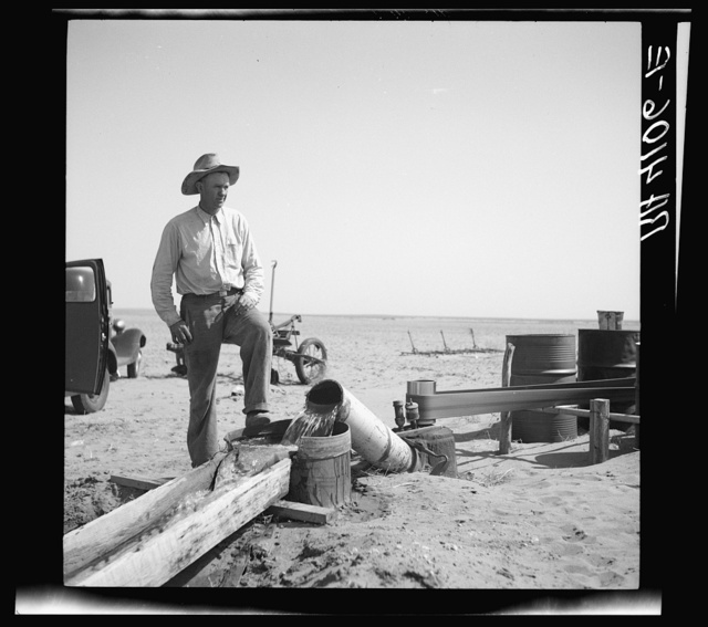 A possible solution to the dust problem is irrigation. This farmer is pumping water from a well to his parched fields. Cimarron County, Oklahoma