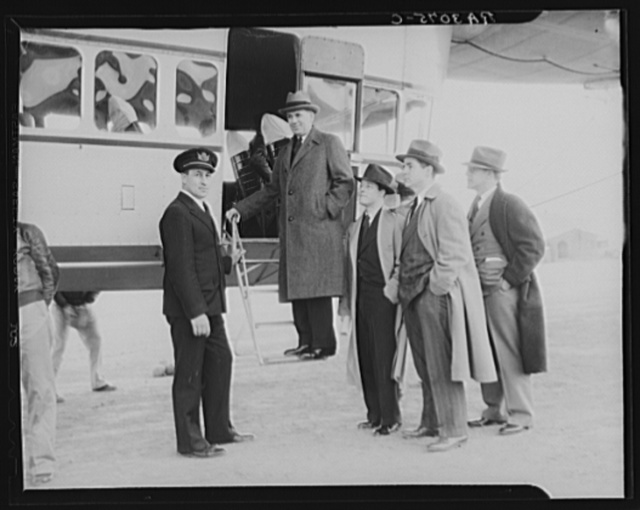 Administrator Tugwell with captain of ship, two of his aides, Mr. Richards and Mr. McManns, and a representative of the Scripps-Howard press, Mr. Brown